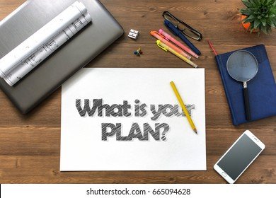 Girl draw text What is your plan and get it on paper sheet at the table with a mobile phone, a laptop, business accessories