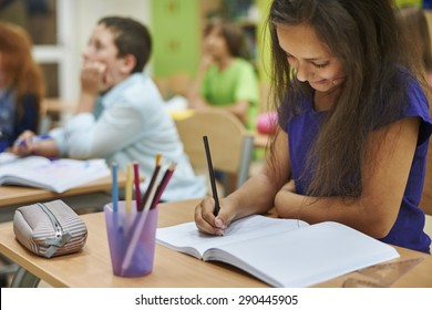 Girl drawing in her notebook