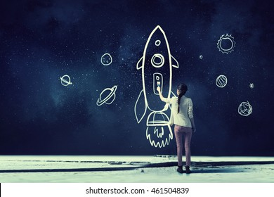 Girl drawing rocket . Mixed media