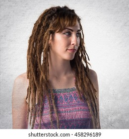 Girl with dreadlocks over textured background