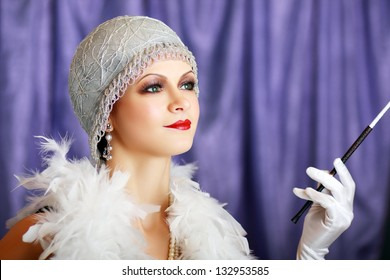 Girl dreaming beautiful young flapper woman from roaring 20s looking at camera