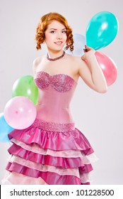 girl in a dress with balloons