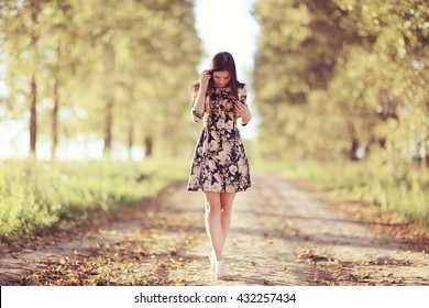 Girl in dress on the summer road