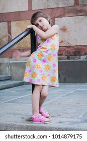 A girl in a dress poses