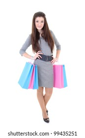 Girl in dress with shopping bags over white