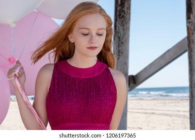 Girl in dress under the pier
