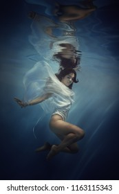 Girl in the dress under the water
