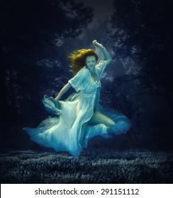 Girl in dress underwater