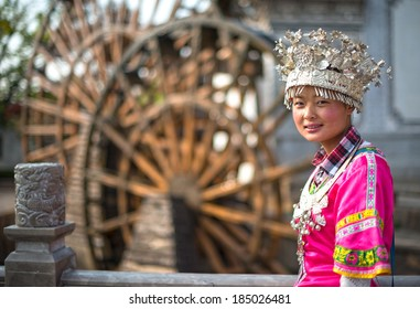 A girl dressed in ancient Chinese Miao nationality clothing. Located in Lijiang Ancient City, Yunnan Province, China.