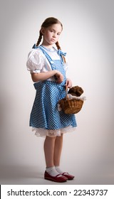 Girl dressed up as Dorothy from Oz - with attitude.