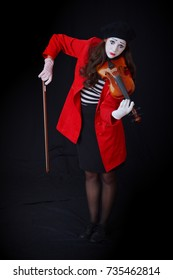 girl dressed like a MIME playing the violin