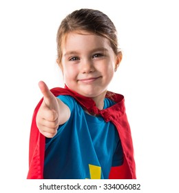 Girl dressed like superhero with thumb up