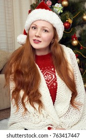 Girl dressed as santa in christmas decoration at home. New year eve and winter holiday concept.
