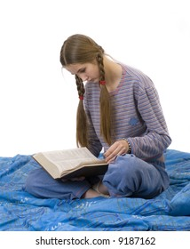 The girl dressing with leisure clothes reads the thick book.