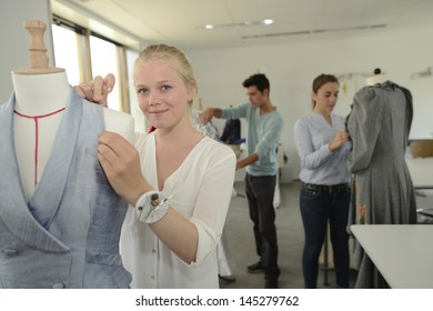 Girl in dressmaking class working on mannequin