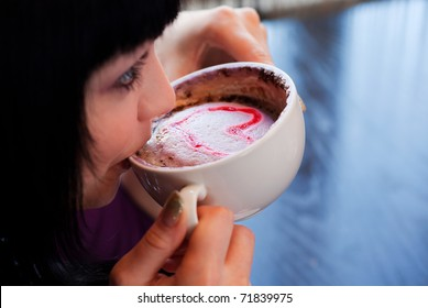 girl drink coffee with heart paint