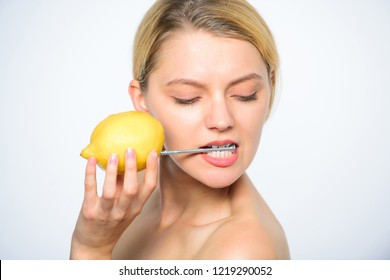 Girl drink fresh juice whole lemon fruit. Recharge your body vitamins. Energy source and vitality. Battery concept. Nutritious drink fill with energy. Lemon with hobnail natural battery.