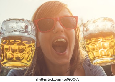 Girl drinking beer outdoors.
