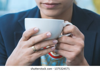 girl drinking cappuccino coffee in a cafe