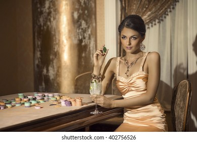 Girl drinking cocktail in casino