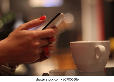 Girl drinking coffee and browsing the internet