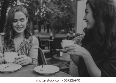 girl drinking coffee in a cafe on the street