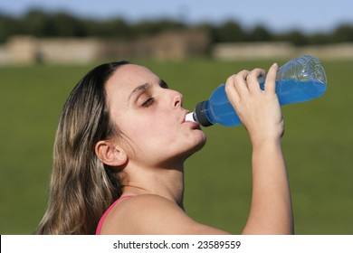 girl drinking an energetic drink