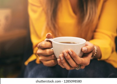 Girl Drinking a Hot Drink and sunshine