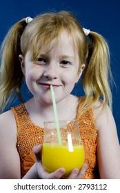 Girl is drinking lemonade
