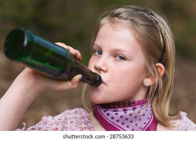 Girl drinking lemonade from a bottle