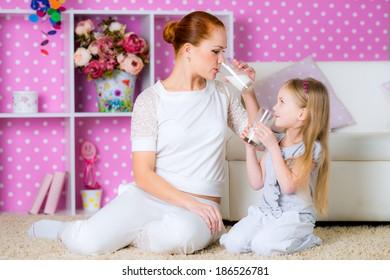 girl drinking milk at bright room