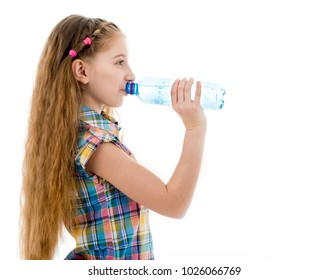 Girl drinking mineral water from bottle