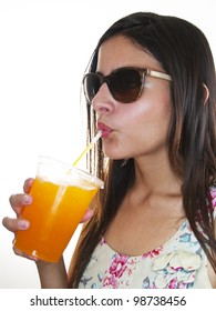 girl drinking an orange frozen drink
