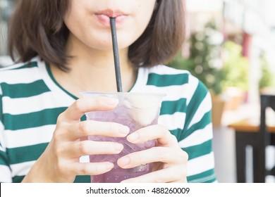 A girl drinking soda juice