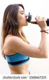 Girl drinking supplement