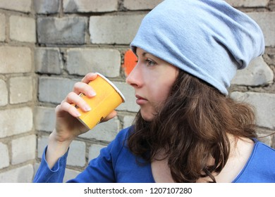 A girl is drinking tea. Autumn background. Protest, used plastic, plastic waste, pollution of nature, pollute, environmental problem, planet ecology, eco, egoist, woman and nature. Zero waste.