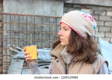 A girl is drinking tea. Protest, plastic, used plastic, pollution of nature, pollute, environmental problem, planet ecology, eco, egoist, man and nature. Do not litter. Zero waste. Plastic free.
