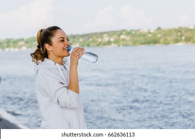Girl drinking water after workout