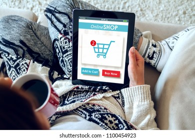 A girl drinks coffee and makes purchases in an online store using a tablet. Online Shopping Concept