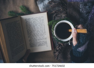 Girl drinks coffee and reads the book