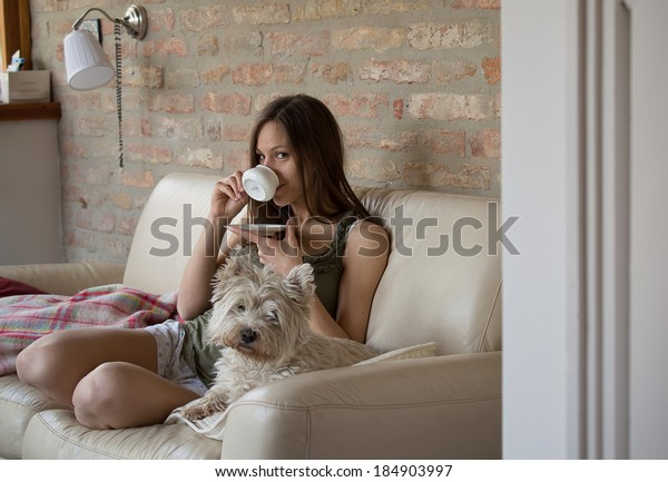 Girl drinks coffee and relax with dog