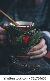 Girl drinks coffee in winter time