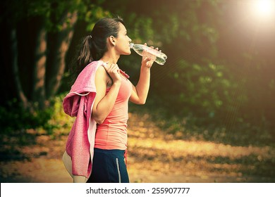 a girl drinks water after sport - Shutterstock ID 255907777