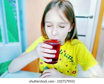 The girl drinks water with pieces of fruit ice. Do not you know how to be refreshed? Try to add to water pieces of the frozen juice and freshness for the whole day to you it is provided.