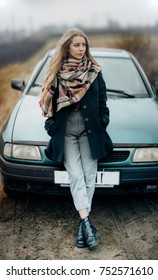 girl driver. The blonde at the car. Fashionable image