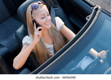 girl driver with mobile phone, in the car