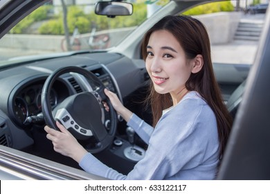 girl drives a car