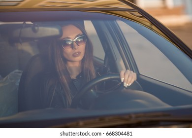 The girl is driving