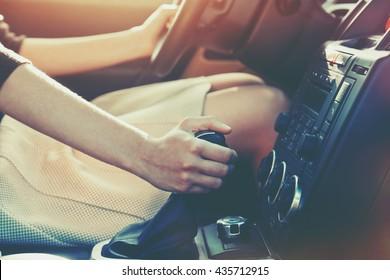 girl driving car moving transmission shift gear