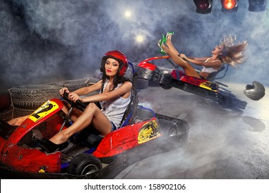 girl is driving Go-kart with speed in Carting
